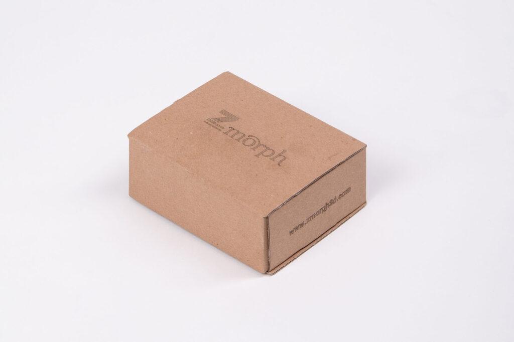 ZMorph logo laser engraved on a cardboard box.