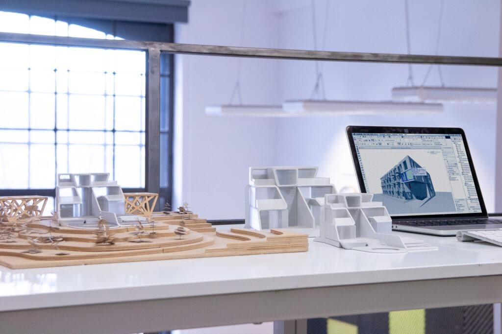 Architectural mockups and a laptop.