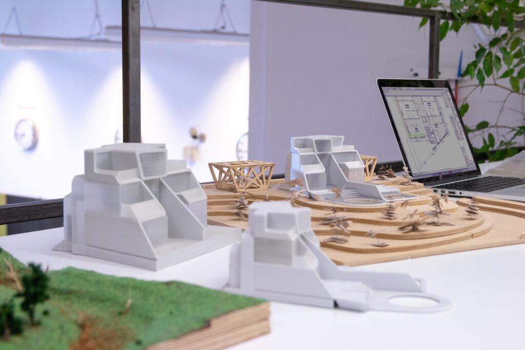 Various 3D printed architectural mockups.
